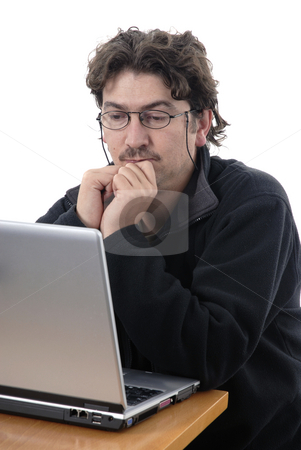 Man stock photo, Young casual man portrait with personal computer by Rui Vale de Sousa