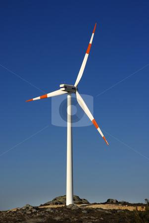 Turbine stock photo, Modern white wind turbine or wind mill producing energy by Rui Vale de Sousa