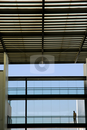 Sillouette stock photo, Man inside the modern building in silhouette by Rui Vale de Sousa