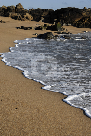 Wave stock photo, White wave in the sand at the beach by Rui Vale de Sousa