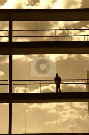 Man stock photo, Worker alone in the modern building in sepia tone by Rui Vale de Sousa