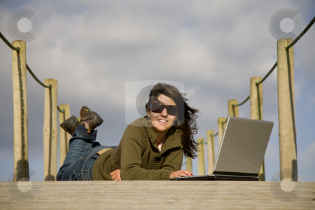 Working stock photo, Young woman working with computer at the beach by Rui Vale de Sousa