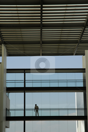 Alone stock photo, Man alone in a office modern building by Rui Vale de Sousa