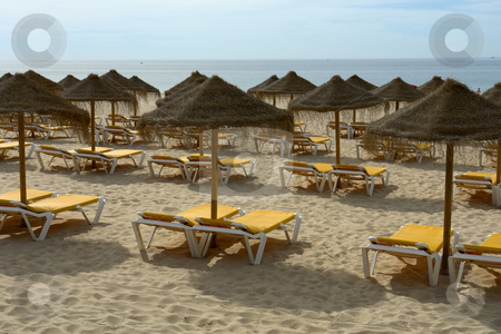 Umbrellas stock photo, Umbrellas on a sunny beach resort at algarve, portugal by Rui Vale de Sousa