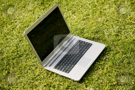 Laptop stock photo, Modern laptop isolated on a green field by Rui Vale de Sousa