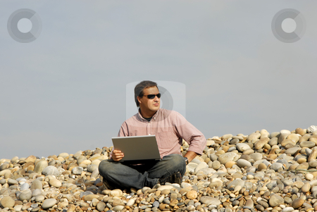 Casual stock photo, Young casual man with laptop at the beach by Rui Vale de Sousa