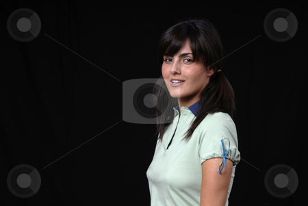 Woman stock photo, Beautiful young woman posing in black background by Rui Vale de Sousa