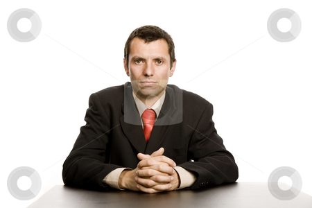 Business man stock photo, Young business man on a desk, isolated on white by Rui Vale de Sousa