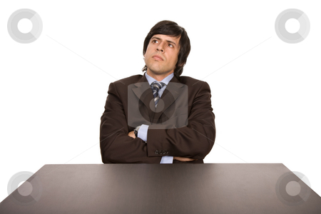 Wondering stock photo, Young business man on a desk, isolated on white by Rui Vale de Sousa
