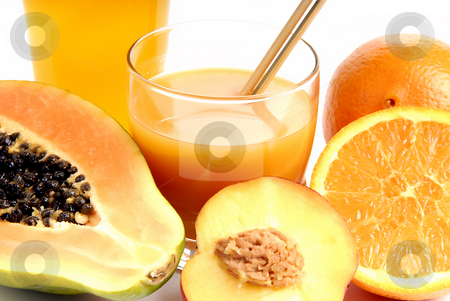 Orange stock photo, A glass of orange juice with cut oranges by Rui Vale de Sousa