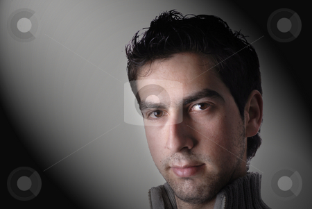 Boy with brown hair stock photo, Young casual man portrait in a black background by Rui Vale de Sousa