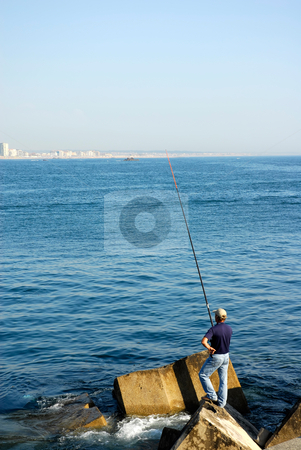 Fisherman stock photo, Fisherman from the back at the ocean by Rui Vale de Sousa
