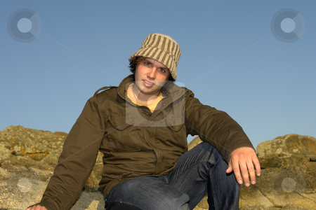Man stock photo, Relaxed young man portrait outdoor with a hat by Rui Vale de Sousa