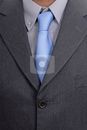 Tie stock photo, Detail of a Business man Suit with blue tie by Rui Vale de Sousa