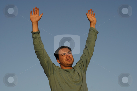 Open stock photo, Young man with arms wide open at sunset light by Rui Vale de Sousa