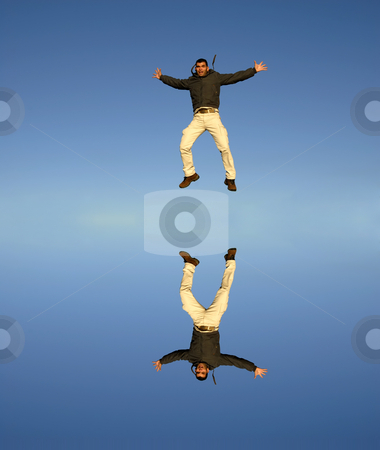 Jumps stock photo, Young man jumps high with water reflection by Rui Vale de Sousa