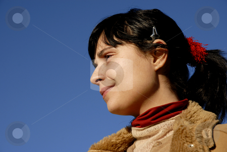 Thoughts stock photo, Young woman close up portrait ans the blue sky by Rui Vale de Sousa