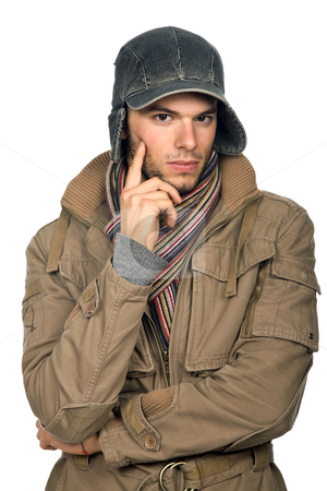 Pensive stock photo, Studio picture of a young man dressed for winter by Rui Vale de Sousa