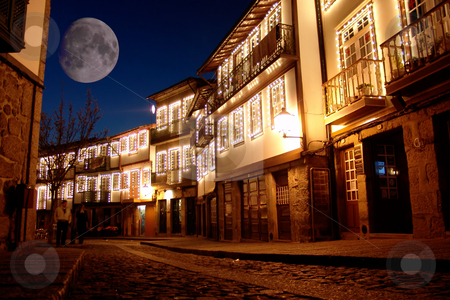 Town stock photo, Big moon over guimarares old town, in portugal by Rui Vale de Sousa