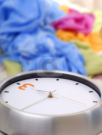 Clock stock photo, Metal clock detail with some colored cloths by Rui Vale de Sousa