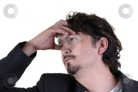 Headache stock photo, Young adult business man looking like has an headache by Rui Vale de Sousa