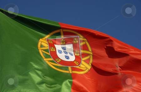Flag stock photo, Real portuguese flag detail with blue sky by Rui Vale de Sousa