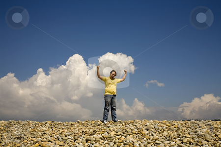 Victory stock photo, Man with arms wide open at the beach by Rui Vale de Sousa
