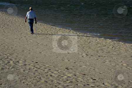 Walking stock photo, Old man walking in the beach sand by Rui Vale de Sousa