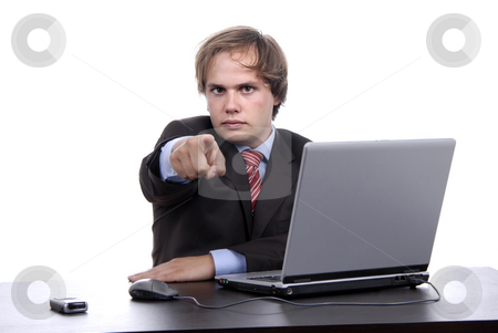 Pointing stock photo, Young man pointing wile working with laptop by Rui Vale de Sousa