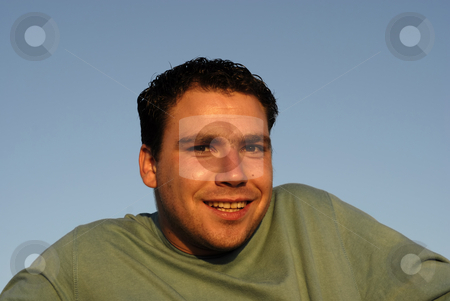 Silly stock photo, Silly face young man with sky as background by Rui Vale de Sousa