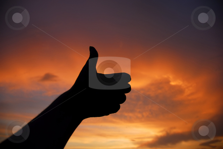 Closed stock photo, Closed hand at the sunset by Rui Vale de Sousa