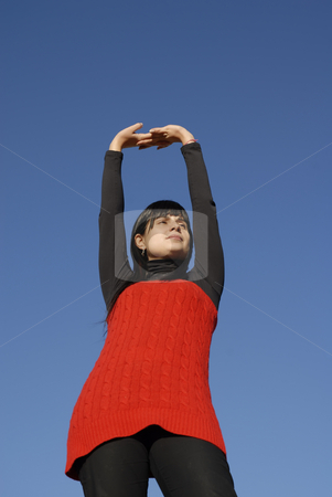 Dancer stock photo, Young woman at the sun with the sky as background by Rui Vale de Sousa