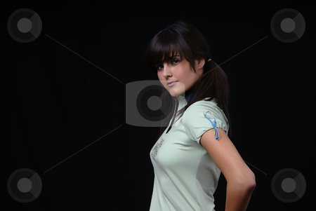 Fashion stock photo, Beautiful young woman posing in black background by Rui Vale de Sousa