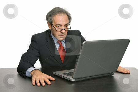 Worried stock photo, Mature business man working with his laptop by Rui Vale de Sousa