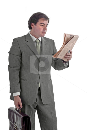 Businessman stock photo, Young businessman with a suitcase and a newspaper by Rui Vale de Sousa