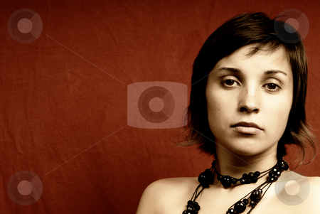 Woman stock photo, Young woman portrait on red background by Rui Vale de Sousa