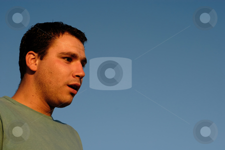 Surprise stock photo, Young man portrait with the sky as background in sunset light by Rui Vale de Sousa
