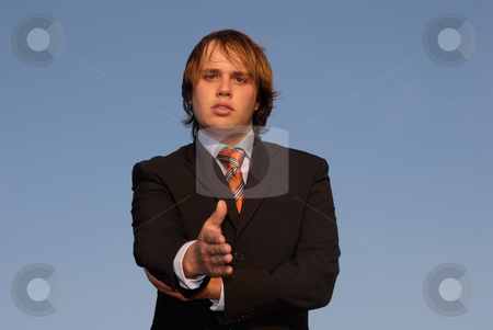 Offering stock photo, Young man offering hand with the sky as background by Rui Vale de Sousa
