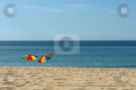Beach stock photo, Colorful beach umbrellas on the beach in the south of portugal by Rui Vale de Sousa