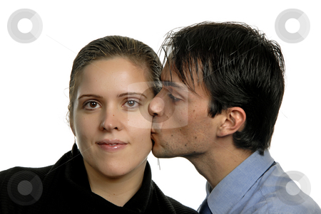 Kiss stock photo, Young couple in a kiss, isolated on white by Rui Vale de Sousa