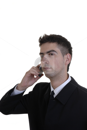 Calling stock photo, Young businessman in black portrait calling by phone by Rui Vale de Sousa