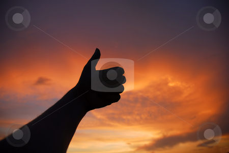 Thumbs up stock photo, Thumbs up human hand in the sunset colors by Rui Vale de Sousa