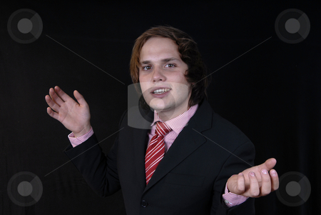 Hands stock photo, Young business man portrait on black background by Rui Vale de Sousa
