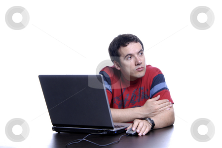Wondering stock photo, Young man wondering and working with is laptop by Rui Vale de Sousa