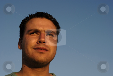 Enjoy stock photo, Young man portrait with the sky as background in sunset light by Rui Vale de Sousa