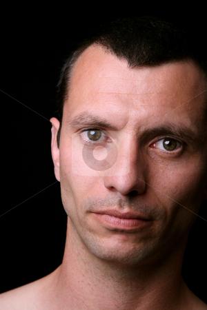 Close stock photo, Young man close up portrait, on black background by Rui Vale de Sousa