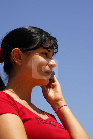 Call stock photo, Young woman with a cell phone and the sky by Rui Vale de Sousa