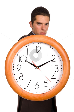 Clock stock photo, Young business man holding a clock, focus on the clock by Rui Vale de Sousa