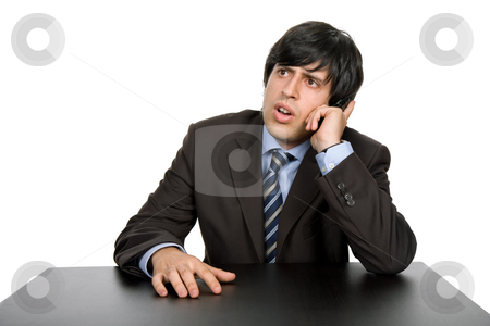 Working stock photo, Young business man on a desk, isolated on white by Rui Vale de Sousa