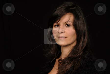 Woman stock photo, Young woman posing in black background by Rui Vale de Sousa